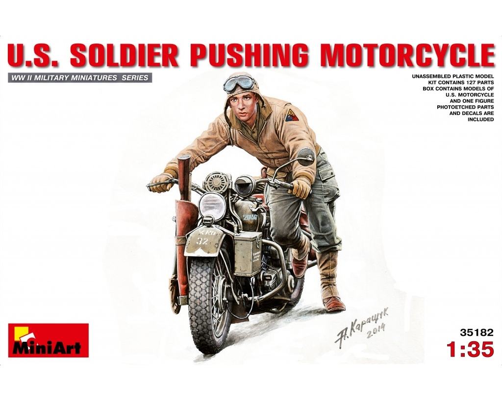 U.S.SOLDIER PUSHING MOTORCYCLE